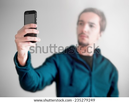Young man taking a selfie photo. Isolated