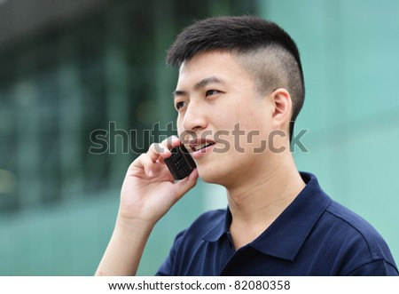 Young man talking on phone outdoors