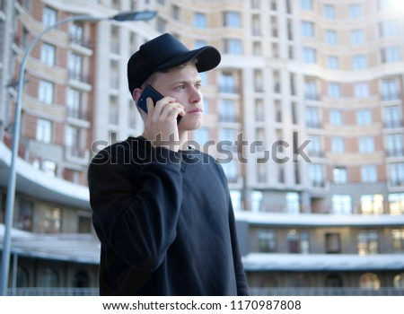 Young man talking on the phone #1170987808