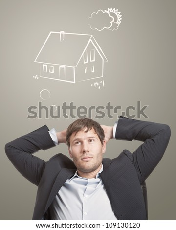 Young man thinking about his dream house