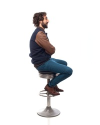 young man thinking with bar stool