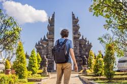 Young man tourist in budhist temple Brahma Vihara Arama Banjar Bali, Indonesia