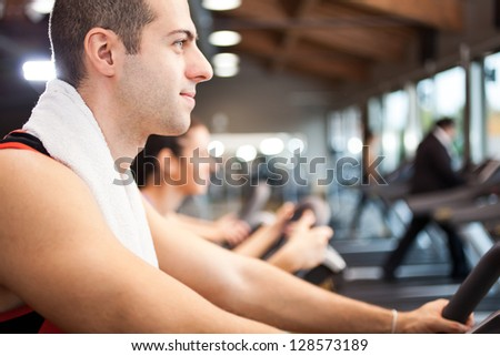 Young man training in a fitness club