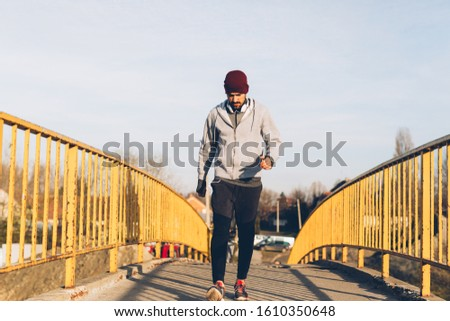 young man training jogging outdoors