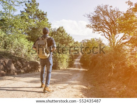 Young Man Traveler with backpack relaxing outdoor with rocky mou #552435487