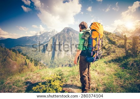 Shutterstock Young Man Traveler with backpack relaxing outdoor with rocky mountains on background Summer vacations and Lifestyle hiking concept
