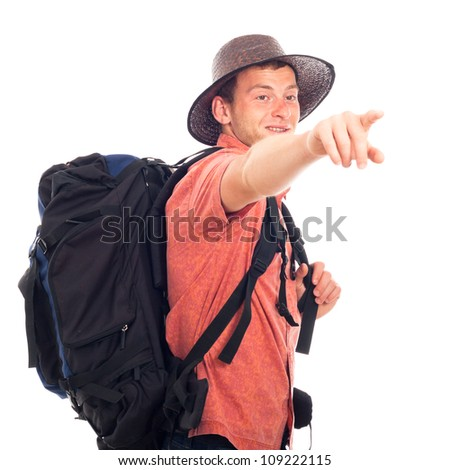 Young man traveling with backpack and pointing the way, isolated on white background with large copy space.