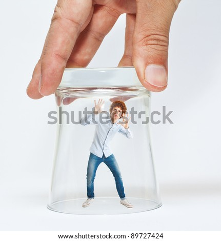 Young man trying to escape from a glass