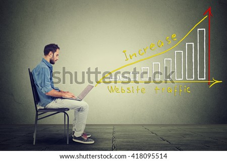 Young man using a laptop. IT guy young man working on notebook has a plan to increase website traffic. Technology marketing concept