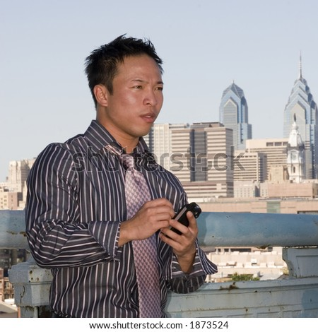 Young man using his PDA - stock photo