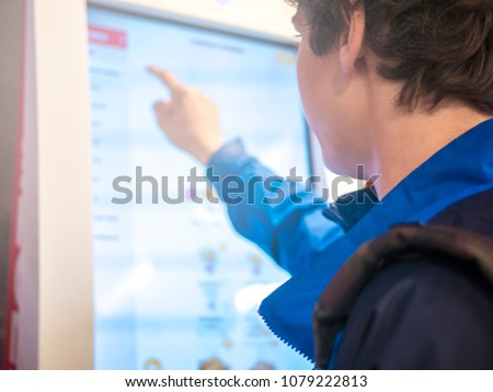 young man using huge touch screen panel close up portrait #1079222813