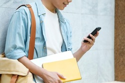 Young man using mobilephone. Online communication concept.