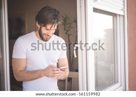 Young man using phone #561159982