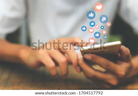 Young man using smart phone,Social Distancing ,Working From Home concept.