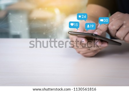 Young man using smart phone Social media and social network Marketing  concept People Connection