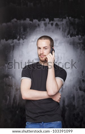 Young Man using smartphone for call, studio shot on black background