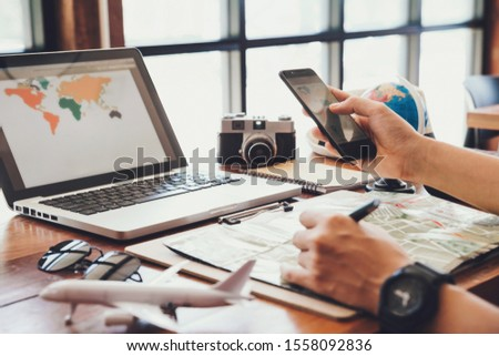 Young man using smartphone planning vacation trip.travel , trip vacation,