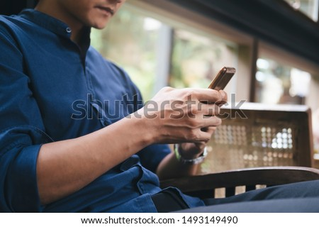 Young man using tablet. Using online connect technology for business, education and communication.