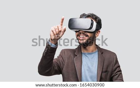 Young man using virtual reality headset, VR, future, gadgets, technology concept Foto stock ©