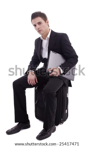 Young man waiting at airport, isolated over white
