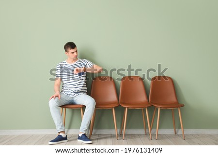 Young man waiting for his turn indoors Сток-фото ©