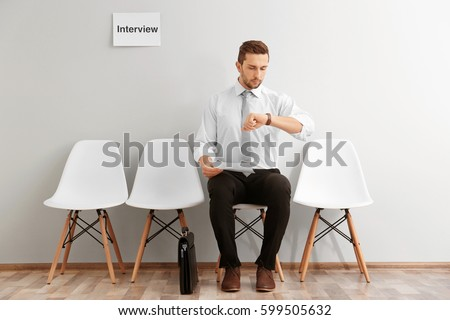 Young man waiting for interview indoors Stockfoto ©