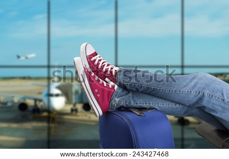 young man waiting for the plane at an airport Stock photo ©