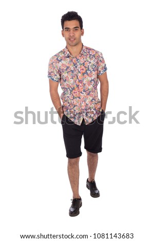 Young man walking hands in pocket, isolated on a white background. #1081143683