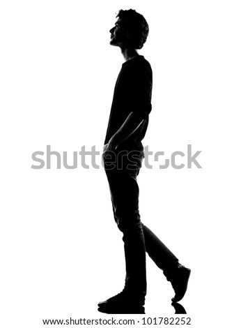 young man  walking happy smiling silhouette in studio isolated on white background