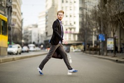Young man walking on the street