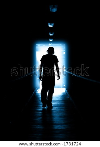 stock-photo-young-man-walking-out-of-the-light-1731724 dans actualité