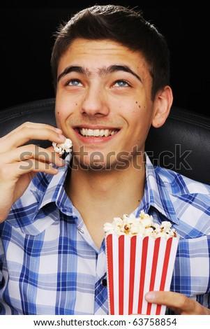 Young man watching movie at cinema