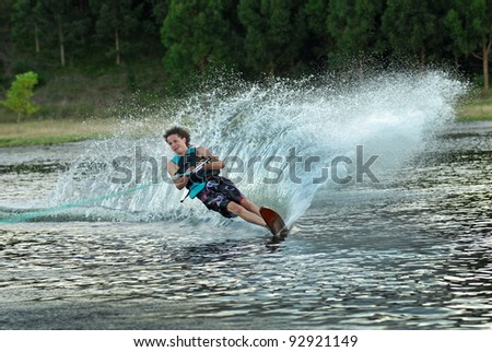 young man water skiing