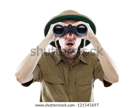 Young man wearing a pith helmet looking through a pair of binoculars with a surprised expression, isolated on white #121545697
