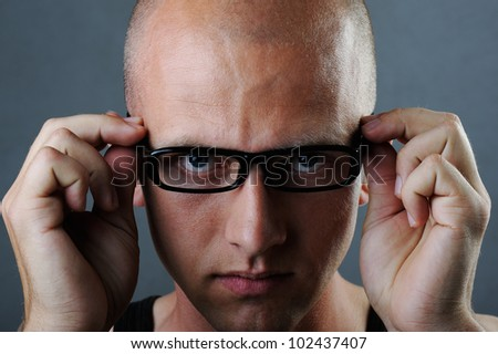 Young man wearing glasses studio portrait