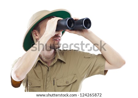 Young man wearing pith helmet looking through binoculars, isolated on white #124265872
