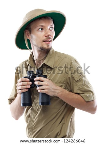 Young man wearing safari shirt and pith helmet holding binoculars, isolated on white background
