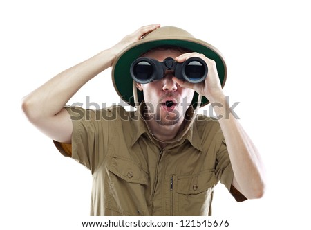 Young man wearing safari shirt and pith helmet looking through binoculars with a surprised expression, isolated on white #121545676