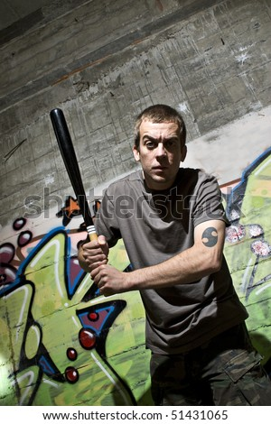 Young man with a baseball bat