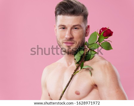 young man with a beautiful body in his hands holding flowers holds an isolated background