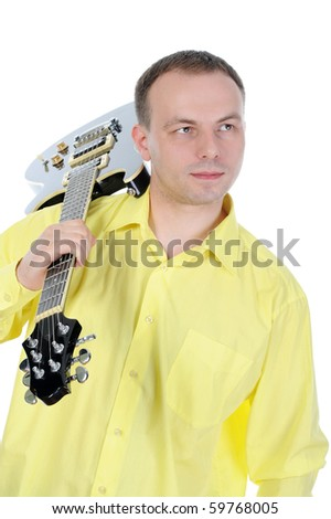 Young man with a black guitar. Isolated on white background