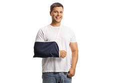 Young man with a broken arm wearing an arm splint and smiling isolated on white background