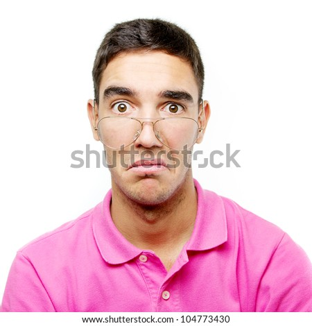 Young man with a contemptuous face over white monochrome background. He is wearing glasses