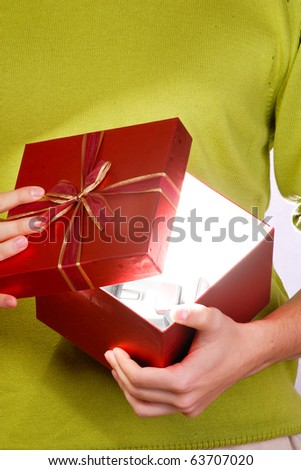 young man with a heart shaped gift