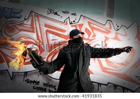 Young man with a molotov cocktail - stock photo