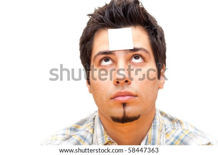 young man with a note stuck to his forehead