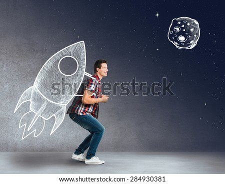 Young man with a rocket on his back