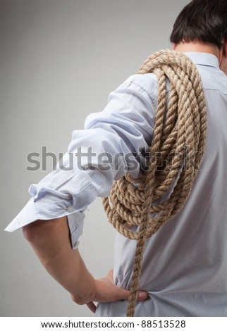 young man with a rope on his shoulder