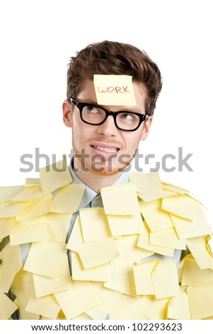 Young man with a sticky note on his face, covered with yellow stickers, isolated on white