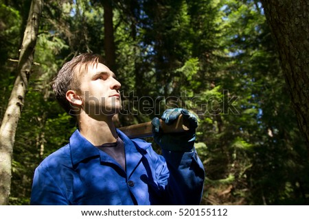 Young man with axe in forest #520155112